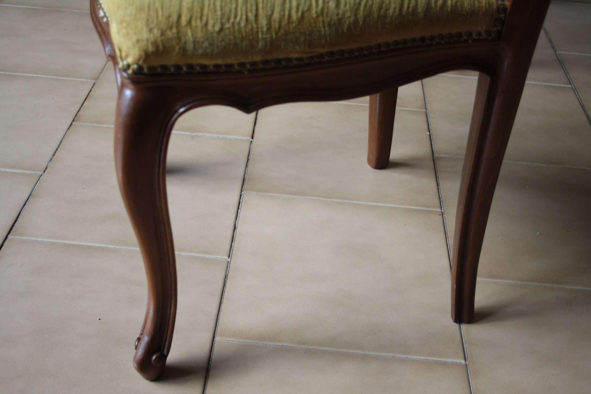 Six walnut wood chairs