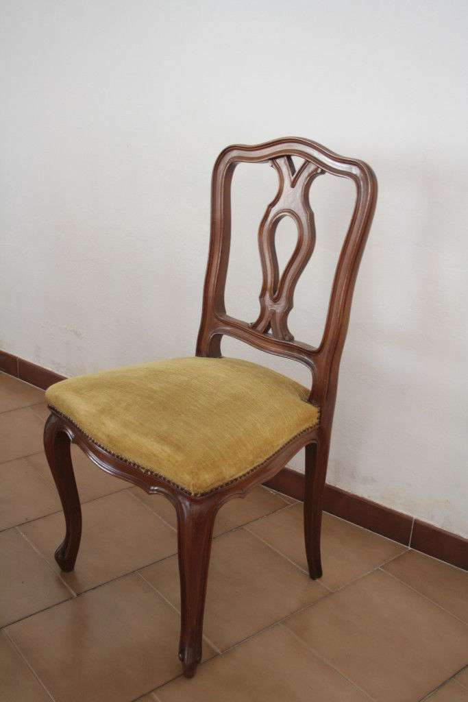 Six walnut wood chairs